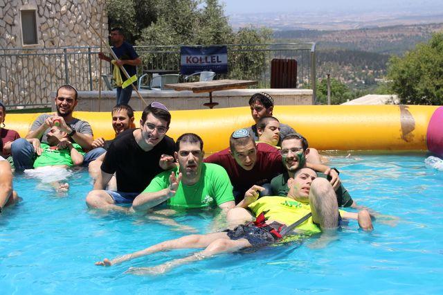 Boys in pool at camp בנים בבריכה בקייטנה
